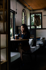 Urban young woman sitting alone in the cafe