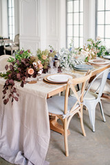 Decorated table in white room