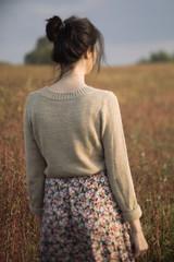 Woman walking on dried field