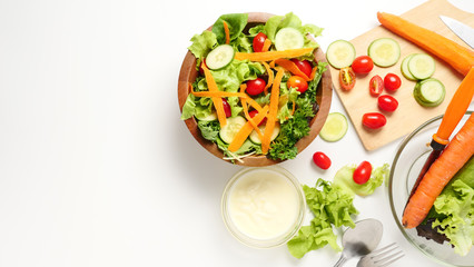 Mixed vegetables salad with cream on white background. copy space