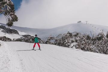 beginner skier on an easy slope