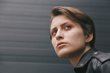 portrait of young androgyne on the street