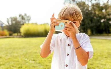 Portrait of a blond kid outdoors