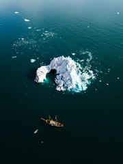 Aerial drone shot from above of Icebergs floating in the arctic close to greenland