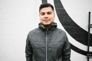 Portrait of Happy young hispanic - latino man standing in front