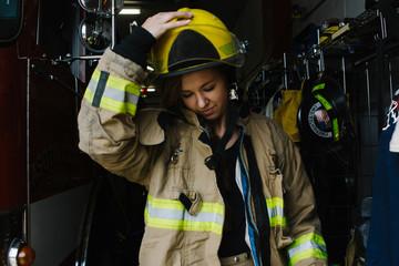 teenage firefighter volunteer wearing firefighting clothing
