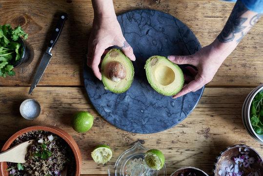 Woman preparing avocado.
