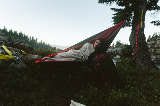 Man Waking Up In Hammock In Mountains