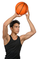Teenager  with sportswear playing basketball. White background.