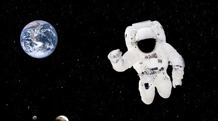 Spaceman close up in outer space. Astronaut in spacesuit close up isolated on black background. Planet Earth from outer space. Elements of this image furnished by NASA