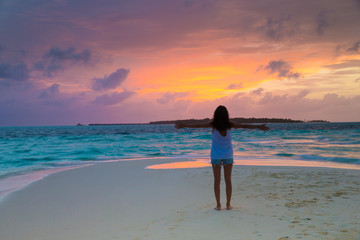 woman relax on the beach. Vacation at Paradise. Ocean beach relax, travel to Maldives islands