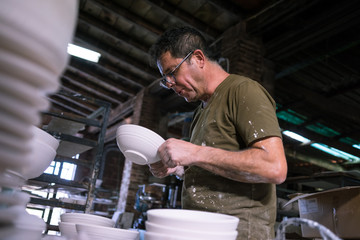Ceramic dishes in working process. Creating ceramic pieces. Tradicional ceramic factory in spain