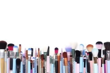 Set of makeup brushes isolated on white background