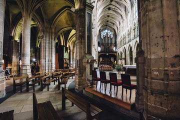 Paris, France - August 13, 2017. Inside view of Saint Pierre de Montmartre Church with arches, columns, pews, vault, aisles, gallery, arcades and clerestory. One of the oldest churches in Paris.