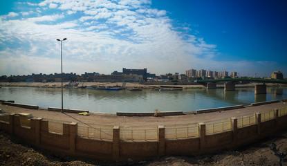Aerial panorama view to Baghdad city and Tigris promenade from Al-Mustansiriya University and Madrasah, Baghdad, Iraq