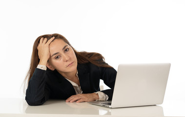 Young beautiful business woman suffering stress working at office computer desk feeling tired and desperate looking overworked overwhelmed and frustrated. In business education, fail and technology