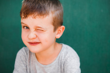 Close up portrait of boy laughing