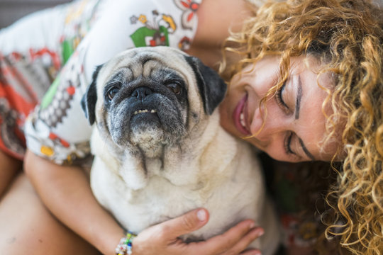 true love between beautiful caucasian woman and old dog pug, Odd friends and family alternative concept. cheerful lady and smile domestic animal. portraits