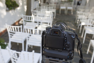 DSLR camera mounted over tripod ready for record wedding