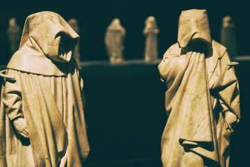 Mysterious friar monks white marble statues.