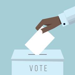 Business hand putting a ballot in a ballot box