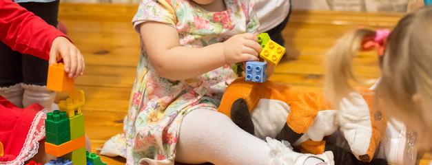 Children play Lego cubes in kindergarten