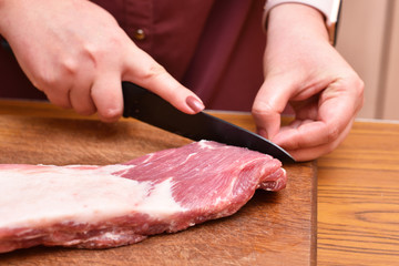 Trim excess fat from pork meat on the ribs. To remove unwanted fat on the meat