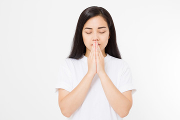 Young asian woman praying isolated on white background. Copy space.
