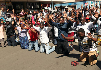 Supporters of the Movement for Democratic Change opposition party of Nelson Chamisa demonstrate outside the party's headquarters as they await results of general elections in Harare