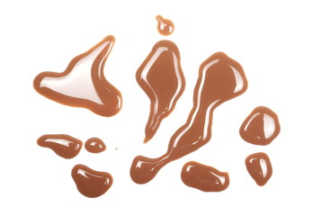 Spilled chocolate milk puddle isolated on white background, top view