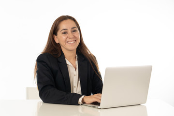 Happy young successful young woman working with laptop computer surfing on the internet sitting on her desk. White background.