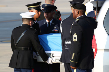 U.N. honor guards carry a casket containing remains transferred by North Korea, at Osan Air Base in Pyeongtaek