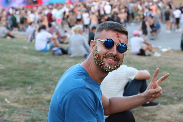 Man with glitter beard in music festival