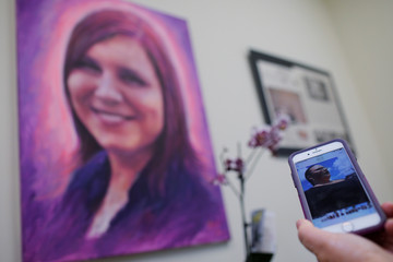 Susan Bro, mother of Heather Heyer, shows a photograph of her daughter in Charlottesville