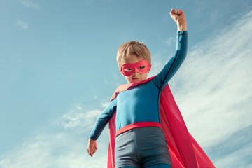 Superhero kid in red cape and mask