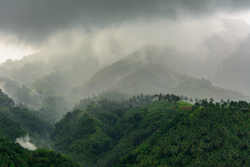Cloudy mountain landscape. Negros Island Philippines. Gloomy landscape in the mountains - fog and clouds thicken in the mountains. Asia
