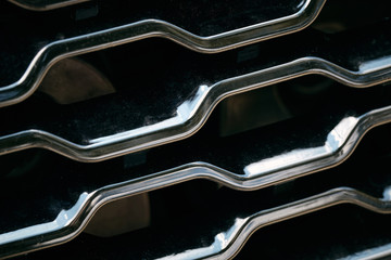 Radiator grille. Metal close-up texture background