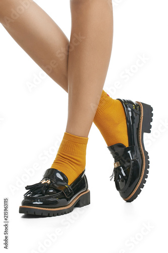 fd8145b4c2ac Cropped side view of beautiful woman s legs in cotton orange socks and patent  leather shoes with ribbed soles
