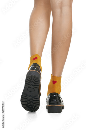 a61678a9195b Cropped back view of beautiful woman s legs in orange socks with red hearts  and patent leather shoes with ribbed soles