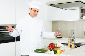 Portrait of the man proffesional who is posing in the kitchen