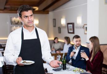 Waiter dissatisfied with small tip