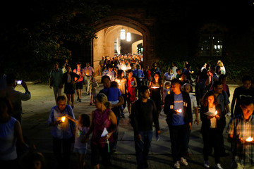 People attend a vigil for Xiyue Wang at Princeton University in Princeton