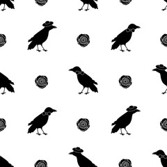 Seamless pattern with black ravens and flowers on the white background