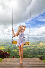 Girs posing near swing on the Redonda mountain
