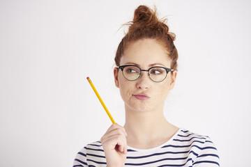 Young woman thinking at studio shot