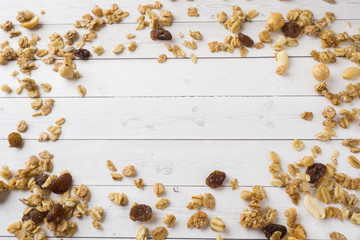 Dry Breakfast of oat flakes, granules and nuts. Muesli on a light table. Copy space