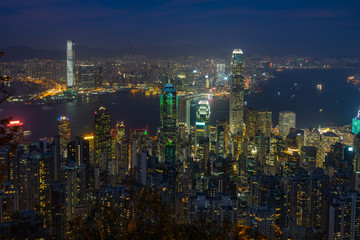 Hong Kong and Victoria Harbour cityscape at night viewed from Lugard Road near Victoria Peak