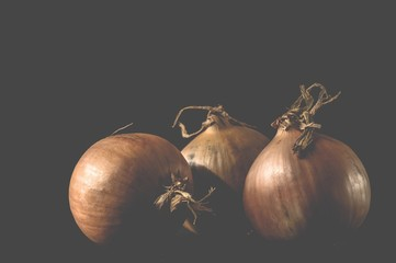 Onions against a dark background...beauty of the raw!