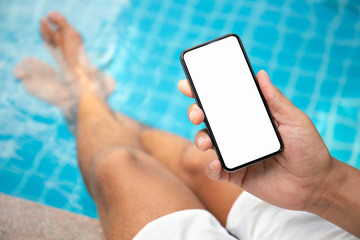 man at the pool holding phone with an isolated screen