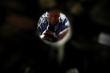 Christos Galanopoulos engraves letters in the interior of a bell mould at the Galanopoulos bell foundry in Paramythia